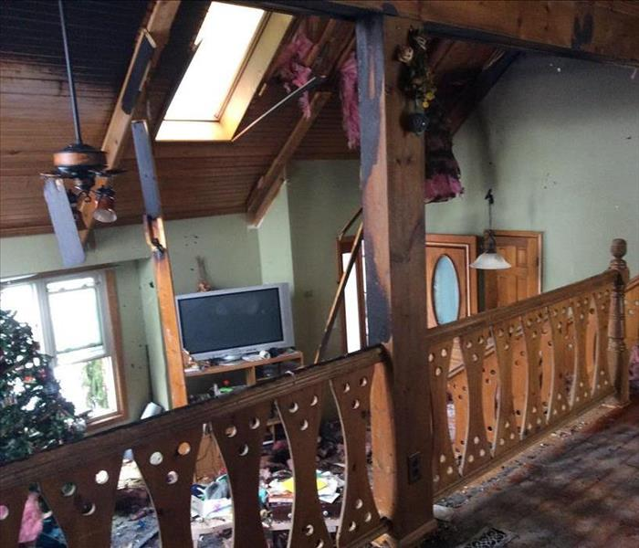 The interior of a home that has been damaged by a fire, debris is scattered everytwherrer