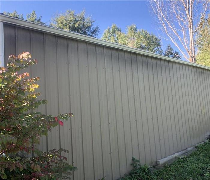 outside of a garage with smoke damage toward the top of the wall