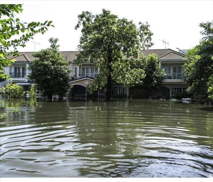 House surrounded by flooding waters