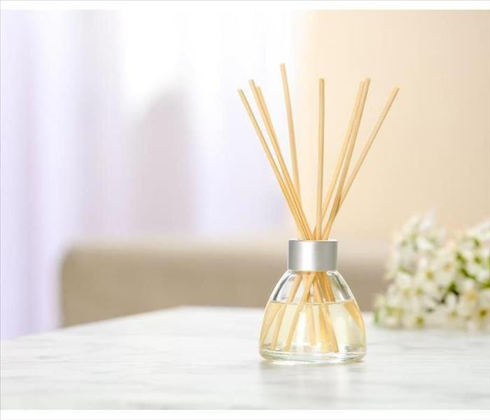 Aromatic reed freshener on table in room